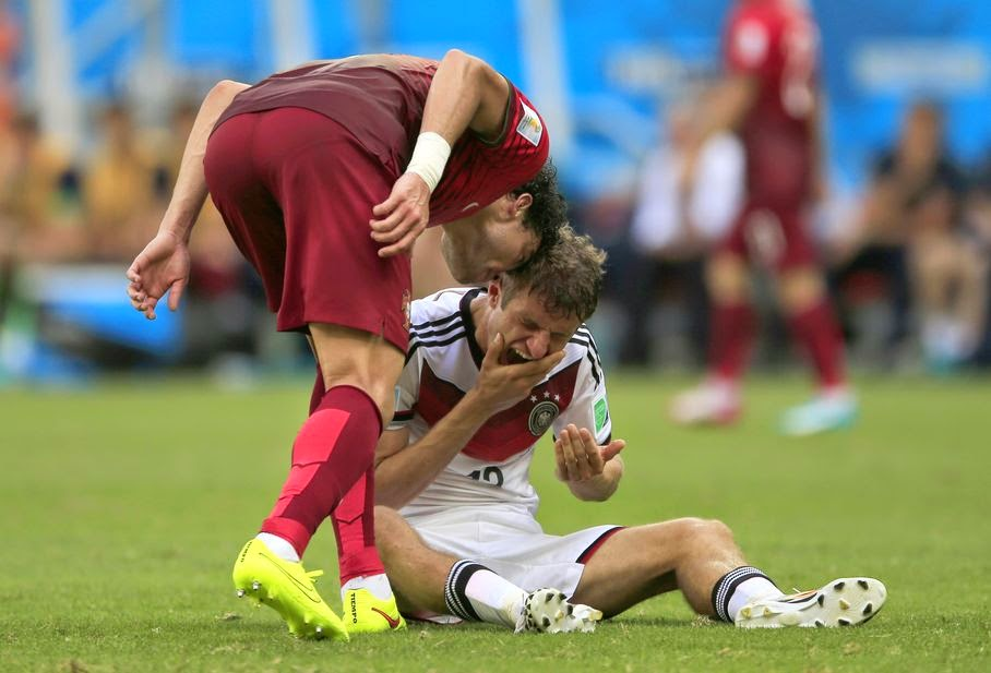 Portugal's Pepe , left, puts his head on Germany's Thomas Mueller during the group G World Cup soccer match between Germany and Portugal at the Arena Fonte Nova in Salvador, Brazil, Monday, June 16, 2014. Pepe was red carded after this.
