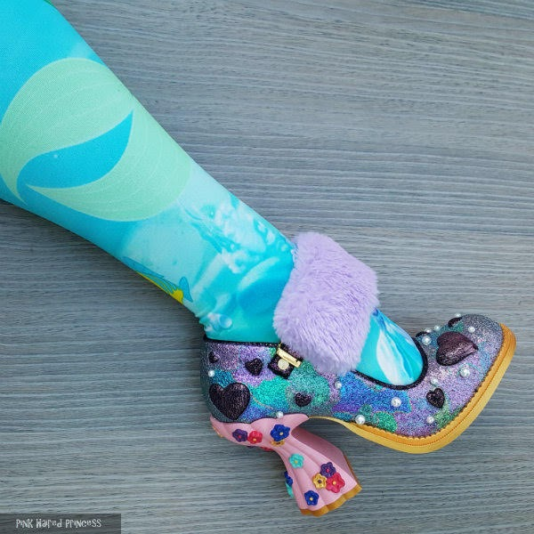 close up of disney mermaid tights wearing colourful shoe with lilac furry strap