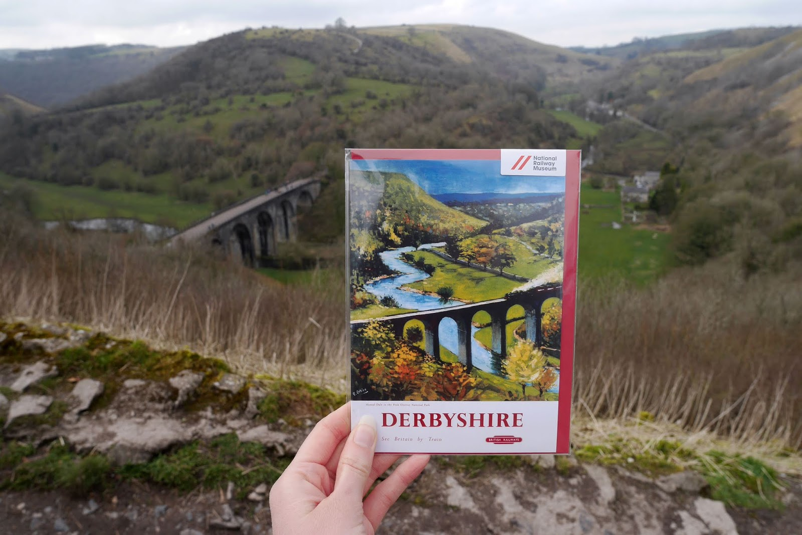 Vintage Derbyshire Railway poster in front of the Monsal Valley, Peak District National Park