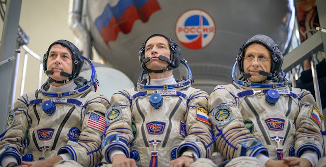 Expedition 49 NASA astronaut Shane Kimbrough, left, Russian cosmonaut Sergei Ryzhikov of Roscosmos, center, and Russian cosmonaut Andrey Borisenko of Roscosmos answer questions from the press outside the Soyuz simulator ahead of their Soyuz qualification exams, Wednesday, Aug. 31, 2016, at the Gagarin Cosmonaut Training Center (GCTC) in Star City, Russia. The trio will fly to the ISS aboard the Soyuz MS-02 spacecraft. Photo Credit: NASA/Bill Ingalls.