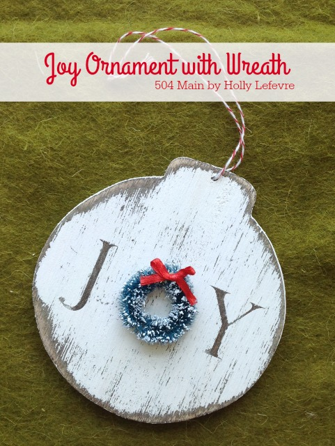white wooden ornament with the word joy - Letter O done with a little wreath