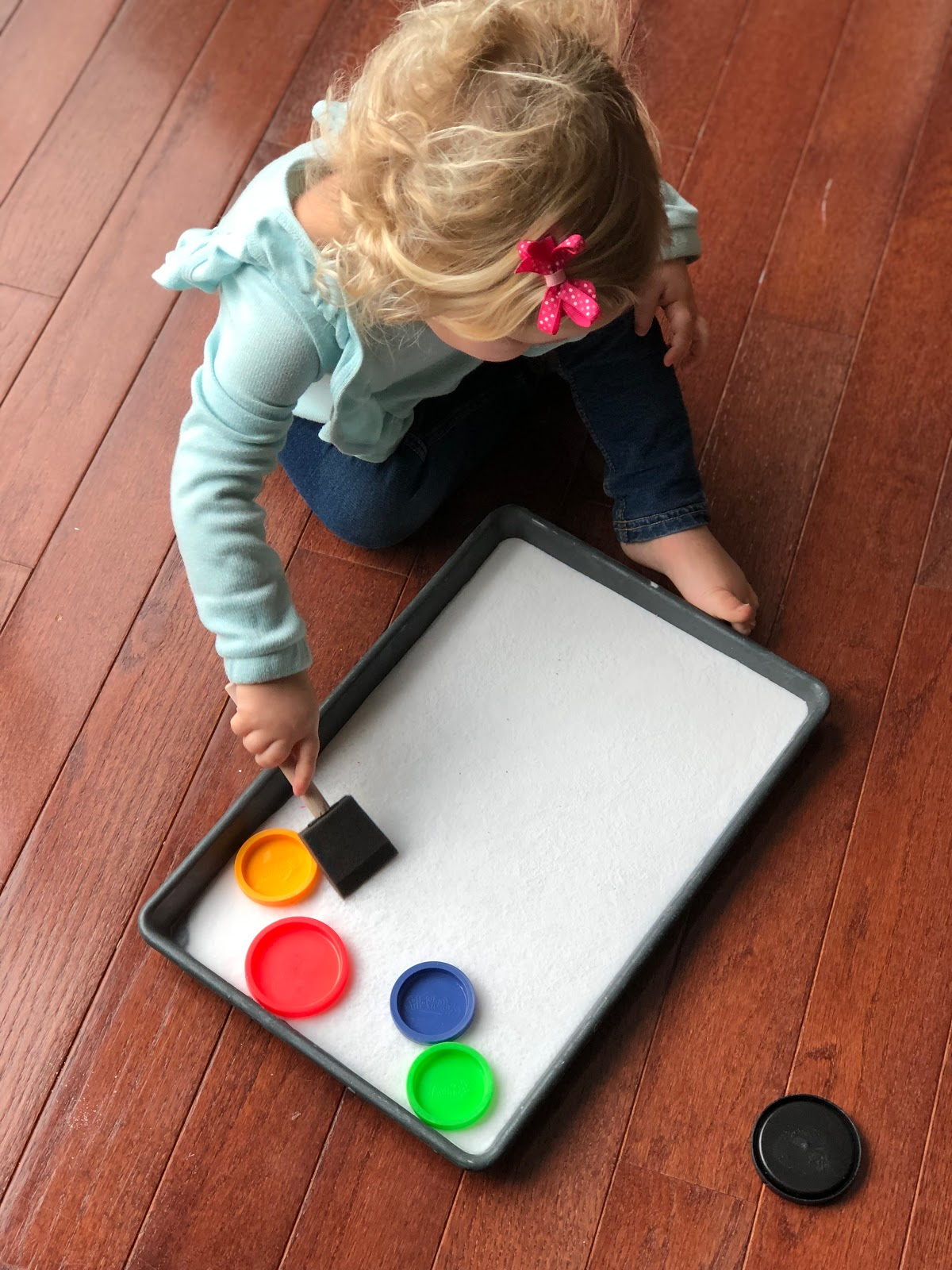 Toddler approved easy lid hockey game for toddlers make sure you put a towel underneath the baking pan so that you dont destroy your floor with baking soda i may know this one from experience solutioingenieria Image collections