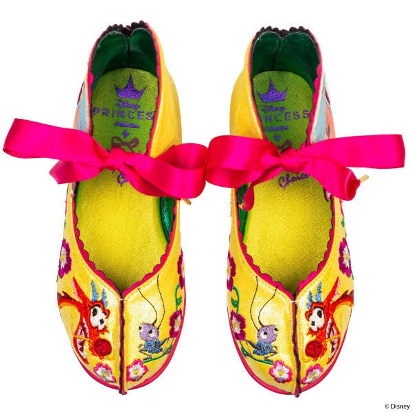 yellow kids shoes with embroidery and pink ribbons and yellow satin lining
