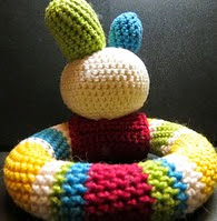 http://www.ravelry.com/patterns/library/playful-baby-loop-rattle