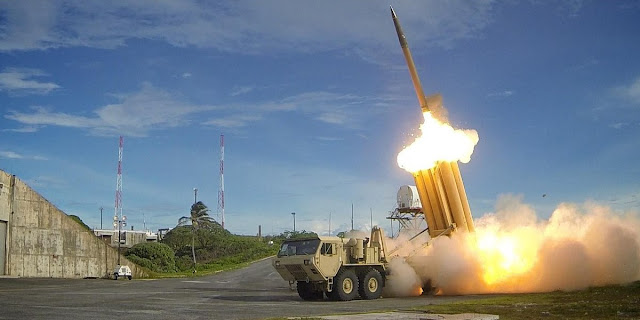 Image Attribute: A file photo of Terminal High Altitude Area Defense (THAAD) interceptor being fired during an exercise in 2013 / Source: U.S. Army Ralph Scott/Missile Defense Agency/U.S. Department of Defense