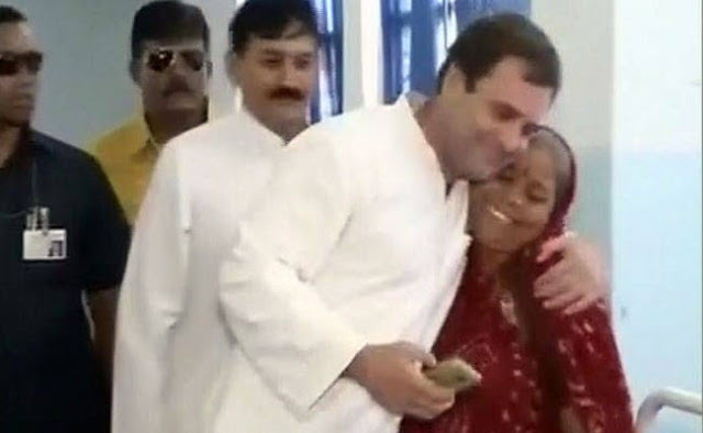 Congress scion Rahul Gandhi had hugged a woman during his last week's visit to Una, Gujarat, where the recently thrashed Dalit youth were undergoing treatment.   A photo of the encounter shows both Rahul Gandhi and the woman breaking into smiles. A few reports identified her as a mother of one of the injured men, while others said she was a relative.    The woman, Ramaben Muchhadiya, is neither, and worse has a criminal record for extortion and rioting, reports NDTV.