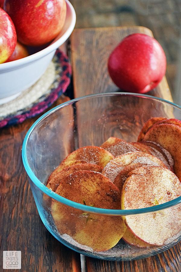 Tossing SweeTango Apples with cinnamon sugar