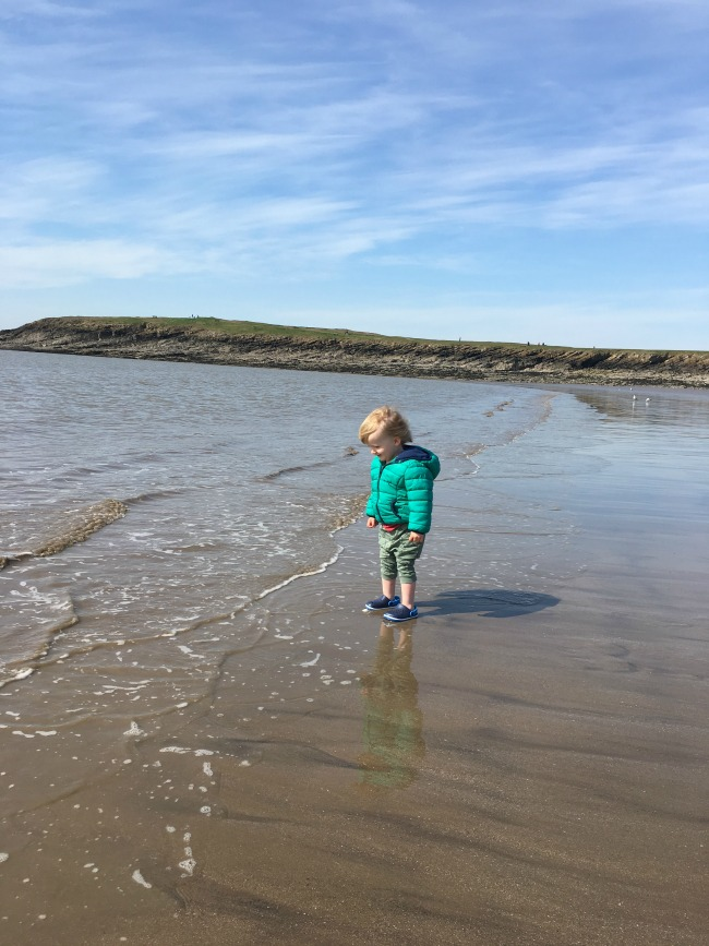 toddler stood in sea