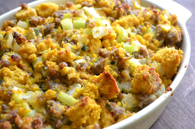 Pumpkin Cornbread Stuffing with Country Sausage and Sage in a casserole dish.
