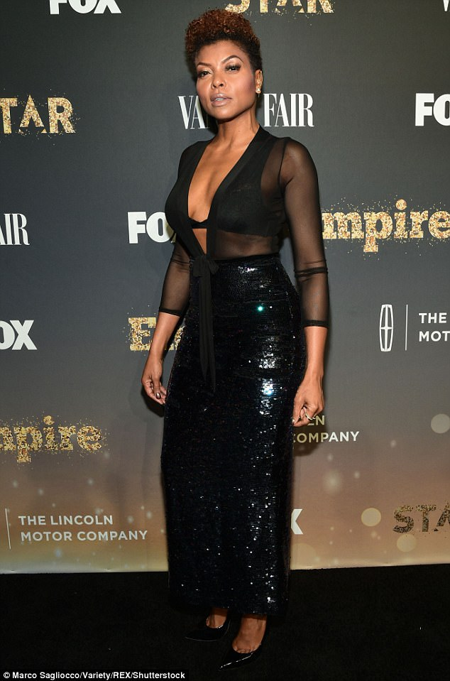 Taraji P. Henson smolders in sheer plunging top and sparkling maxi skirt