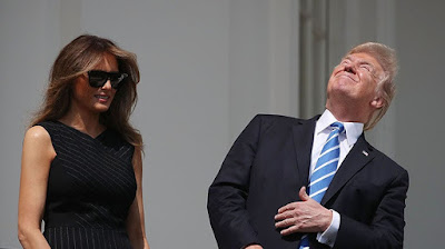 Donald Trump sun total solar eclipse eyes blind damage balcony Fake News Melania