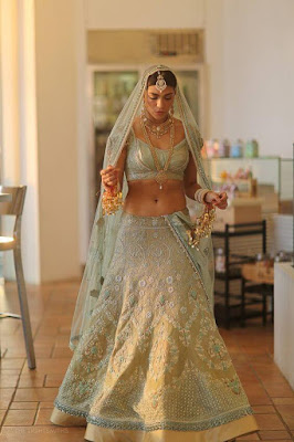 Beautiful Indian Bride Looking Stunning In Icy Seafom and Golden Lehenga.