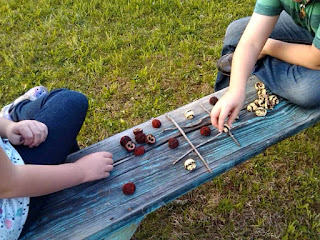 Make an eco friendly tic tac toe game from found objects.
