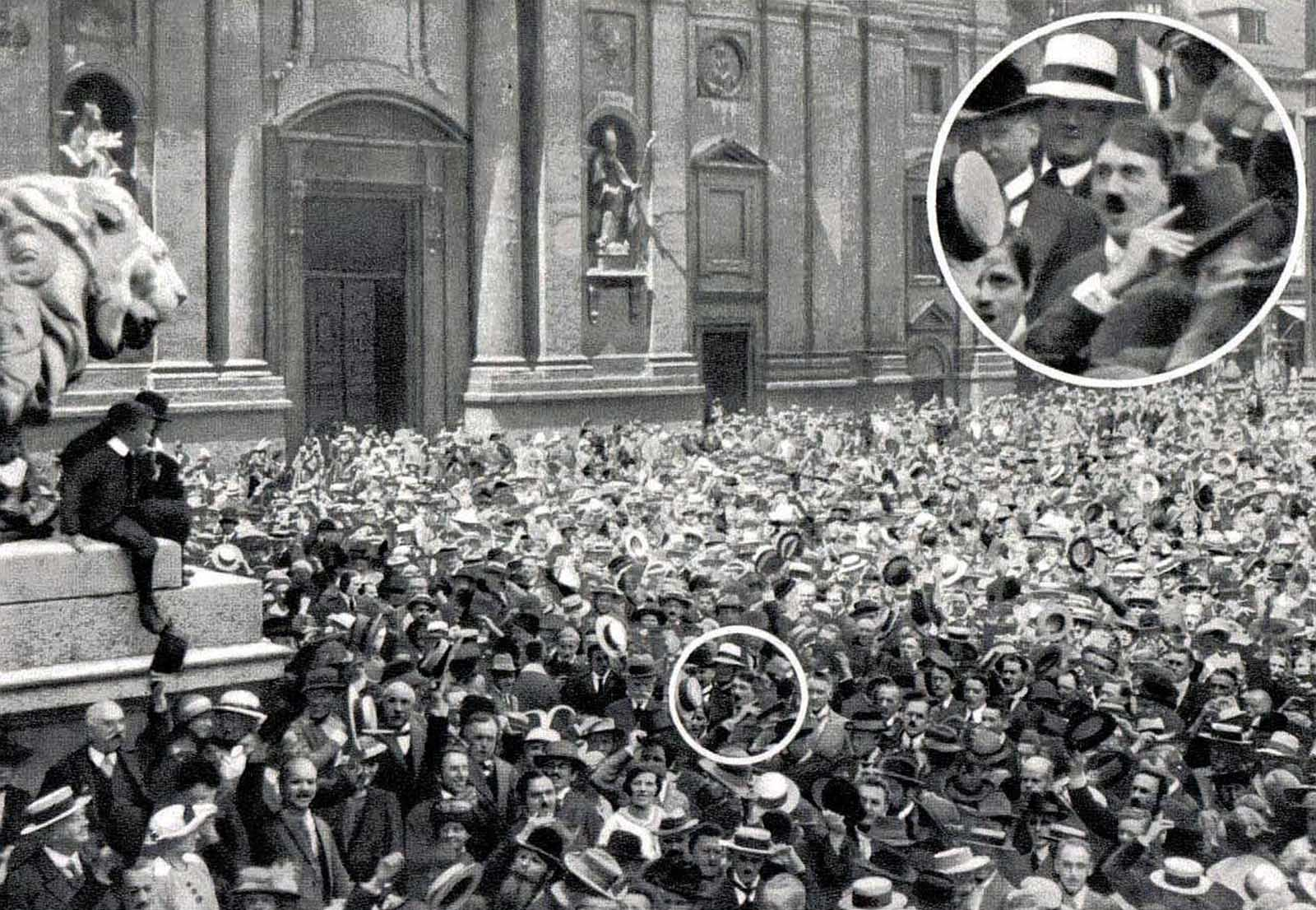 "The original caption: ""Adolf Hitler, the German patriot in the middle of the crowd stands with blazing eyes""."