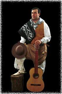 Payador con guitarra y sombrero