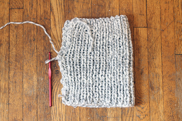"Fold the knitted rectangle in half & ""stitch"" along the side"