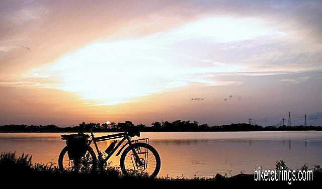 Picture of touring bike with Nassau Bay sunset in background
