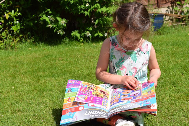 child Reading Go Jetters magazine