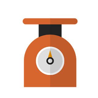 orange kitchen scales with needle in the middle