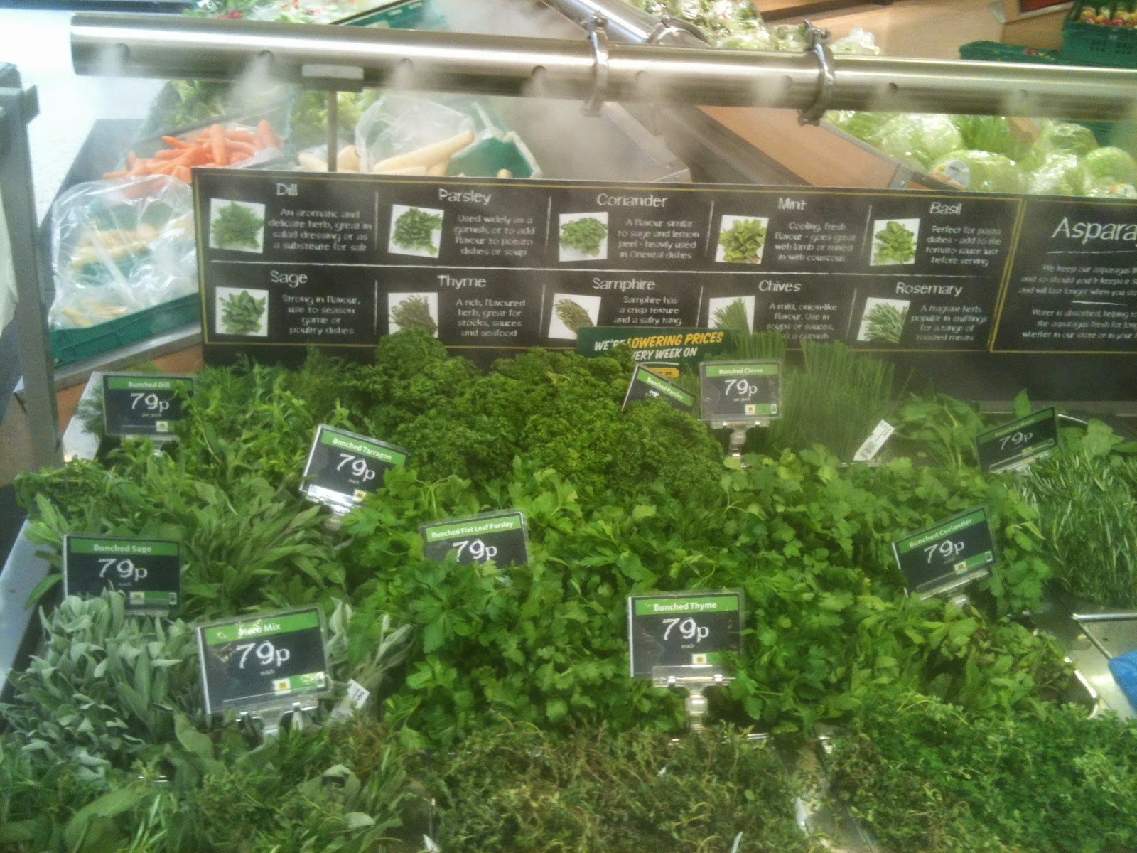 Herbs under the cold steam spray at Morrisons