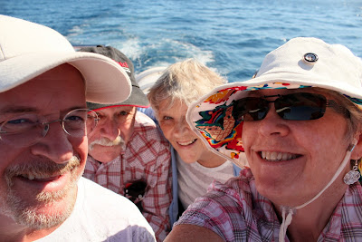 Pete, my brother-in-law , my sister and me, the consummate tourista