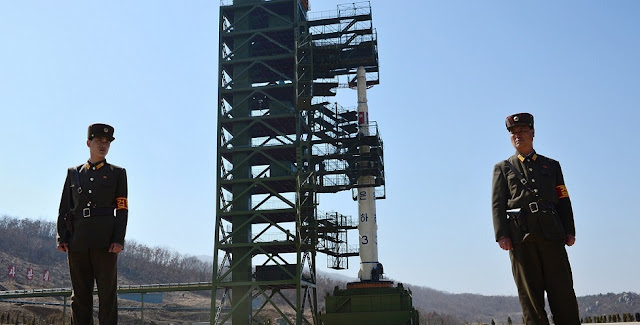 North Korean soldiers standing guard in front of the Unha-3 rocket in 2012. Photograph: Pedro Ugarte/AFP/Getty Images