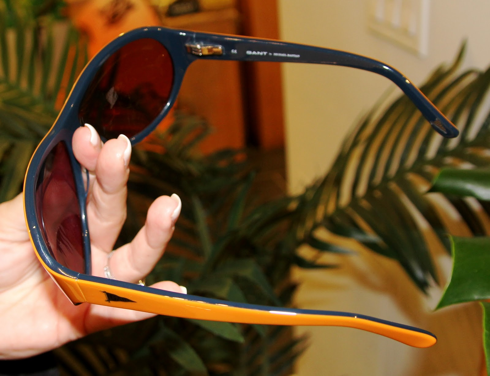 0f65ec267 Greg sunglasses get groovy with orange over navy frames with grey lenses  $195