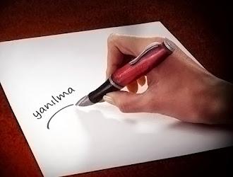 İşaret parmağının bir dolma kalem olarak göründüğü göz yanılması resmi