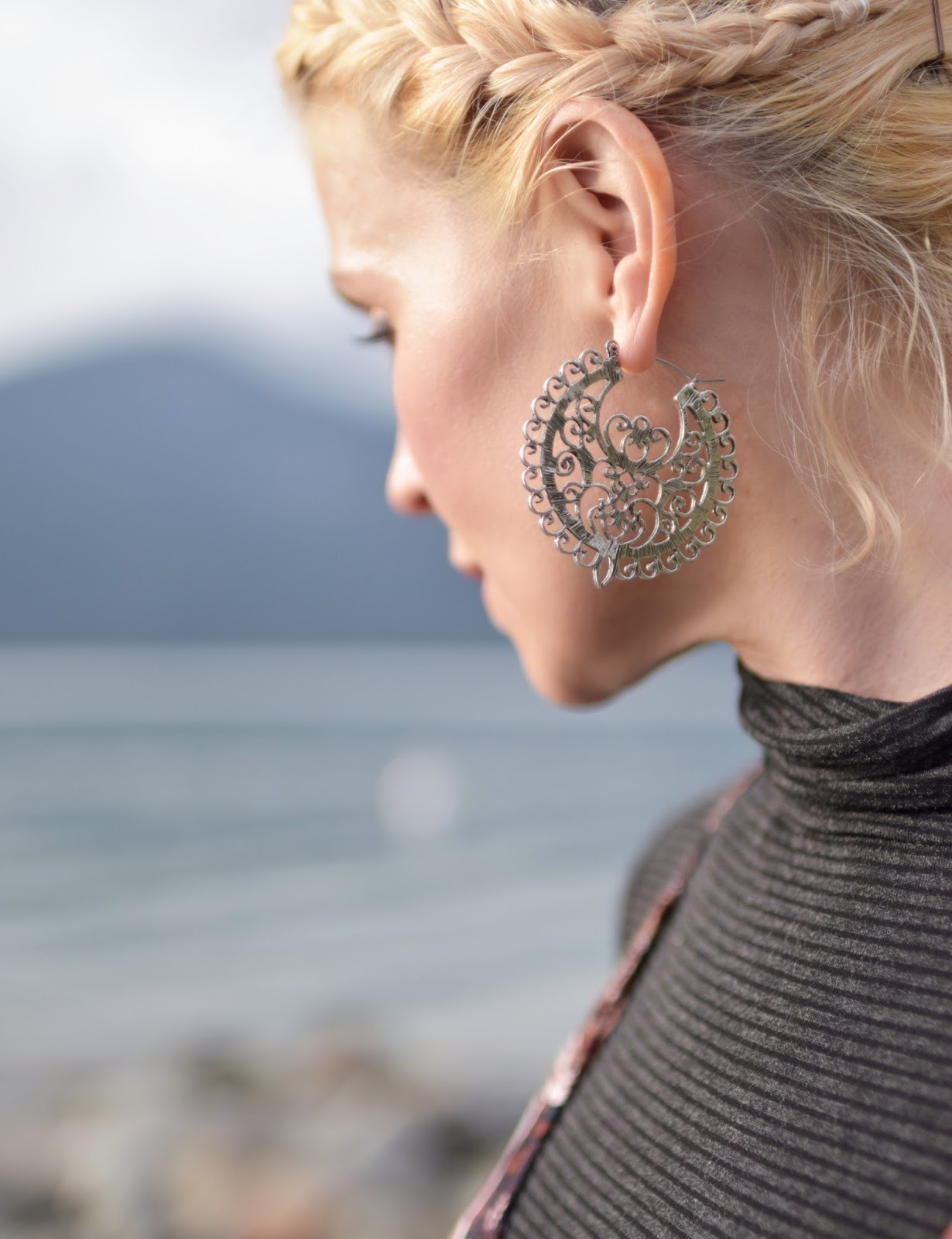 filigree earring, french-braided hair