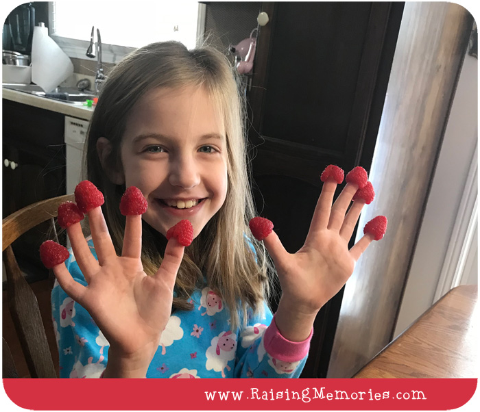 Making Snacks Fun for Kids: Putting Raspberries on Fingertips