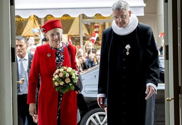 The Queen arrived at Flensburg Harbour with the Royal Ship Dannebrog. Hale Bob red outifit floral print dress
