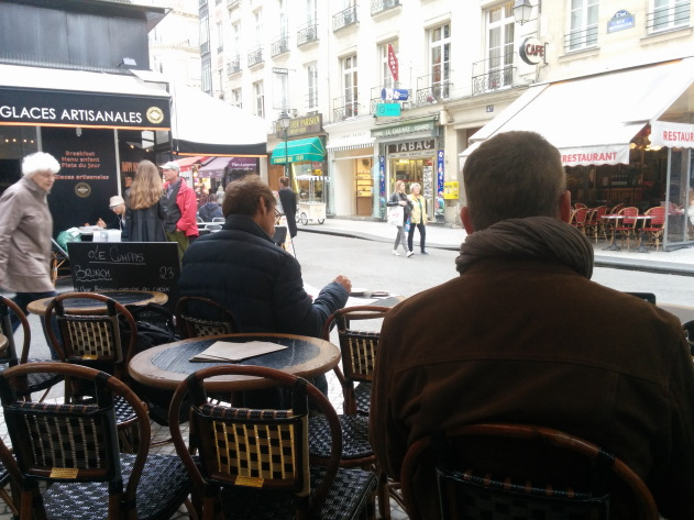 Chairs of coffee shops in Paris face the street
