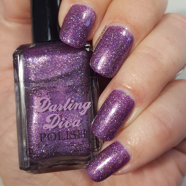 Purple glitter polish with iridescent flakes
