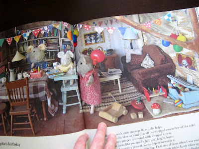 "Inside spread from the book 'Mouse Mansion: Sam and Julia"", showing a miniature dining room."