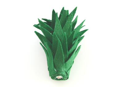 pineapple crown made out of felt on a white background