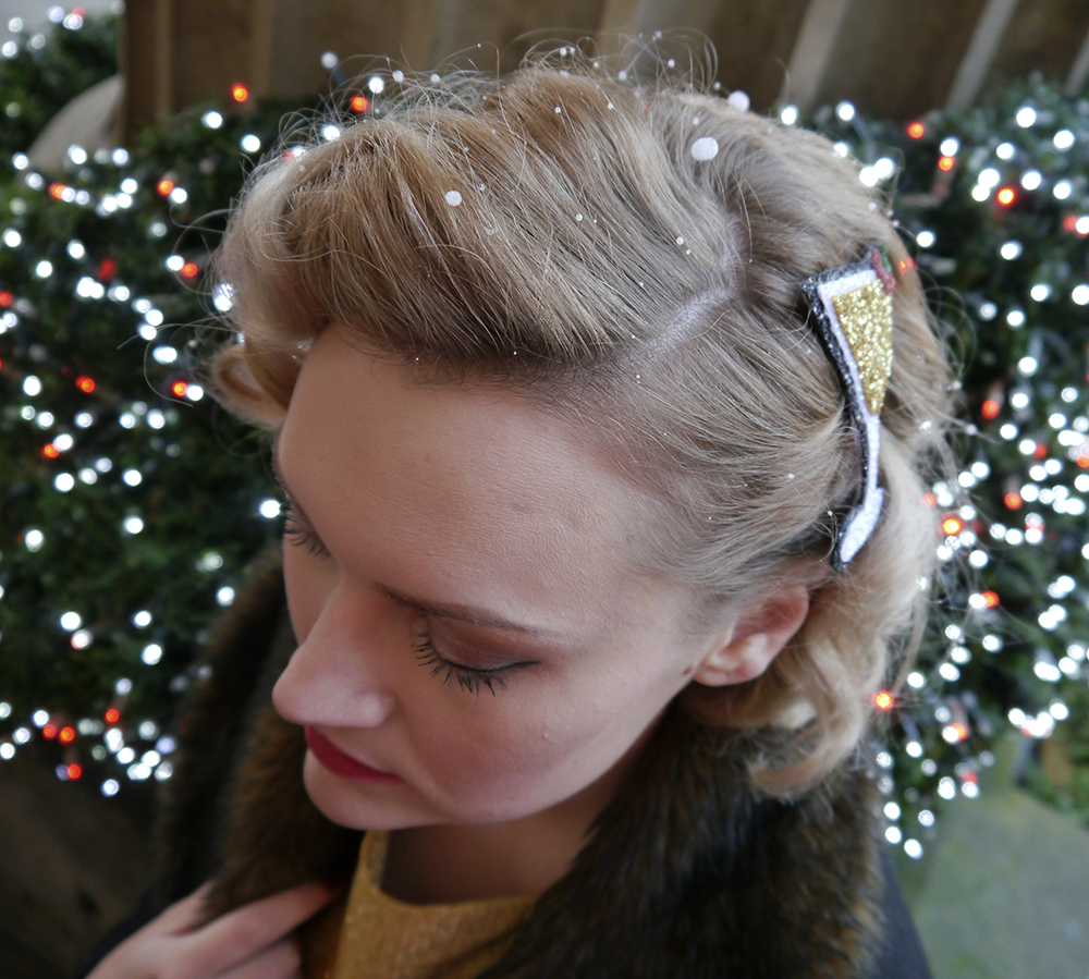 British vintage style blogger, faux fur trimmed Henry Holland coat, gold glitter clutch for christmas party, easy vintage pincurl style with tongs, fashion blogger christmas outfit, alternate normality cocktail hair accessory