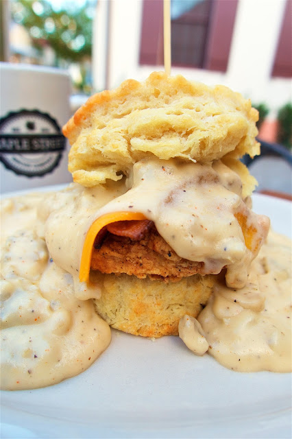Maple Street Biscuit Company - The Five - Flaky biscuit, all natural fried chicken breast, pecan wood smoked bacon, cheddar cheese topped with sausage gravy with a little kick. The BEST sausage gravy I've even eaten!