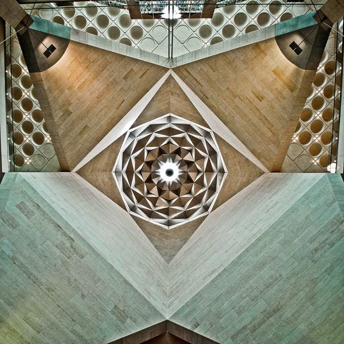 Looking straight up in the center of the lobby in this beautiful building in Doha, Qatar.