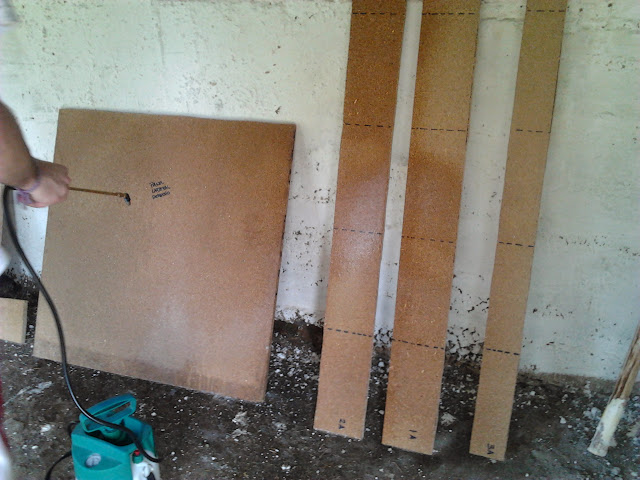 Desinfectando las piezas de madera para el ponedero escamoteable