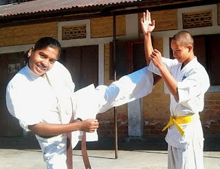 Subrati Baraik performs karate with a student in Jaigaon