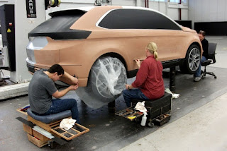 modelers working on the lower areas of car model