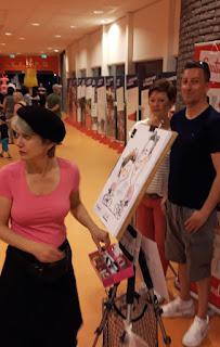 live caricaturist Marion van de Wiel in Giro d'Italia kleur Roze