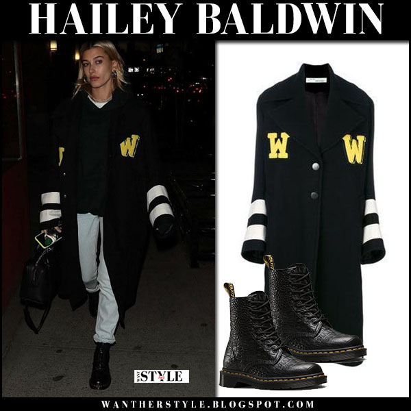 Hailey Baldwin in long black varsity coat off-white and ankle boots dr. martens street fashion january 26