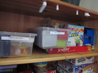 Put Small games and cards in catch-all bins or containers