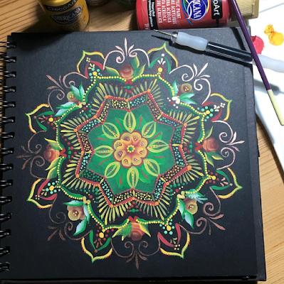 Handpainted mandala created using colours inspired by Jamaica