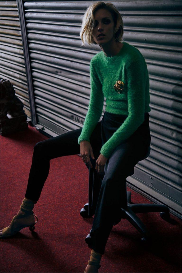 Anja Rubik models green Zara sweater and gold hoop earrings