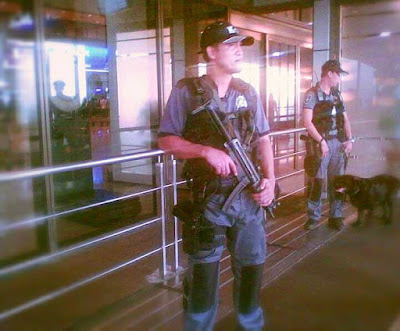 guarding airpot officials - k9 search and rescue unit
