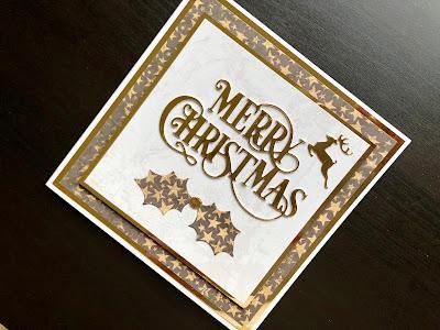 Die cut merry Christmas card with die cut holly and reindeer