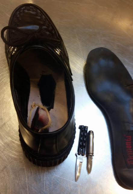 Discovered two knives inside a hidden compartment in the sole of a shoe