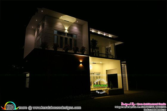 Night photograph of a modern Kerala home